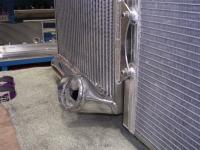 Radiator to intercooler bracket