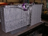 Intercooler shaped header tanks