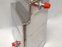 Shaped dry sump tank