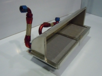 Oil cooler / radiator combination with air duct and fans.