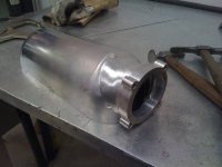 Plenum body with inlet tacked in place