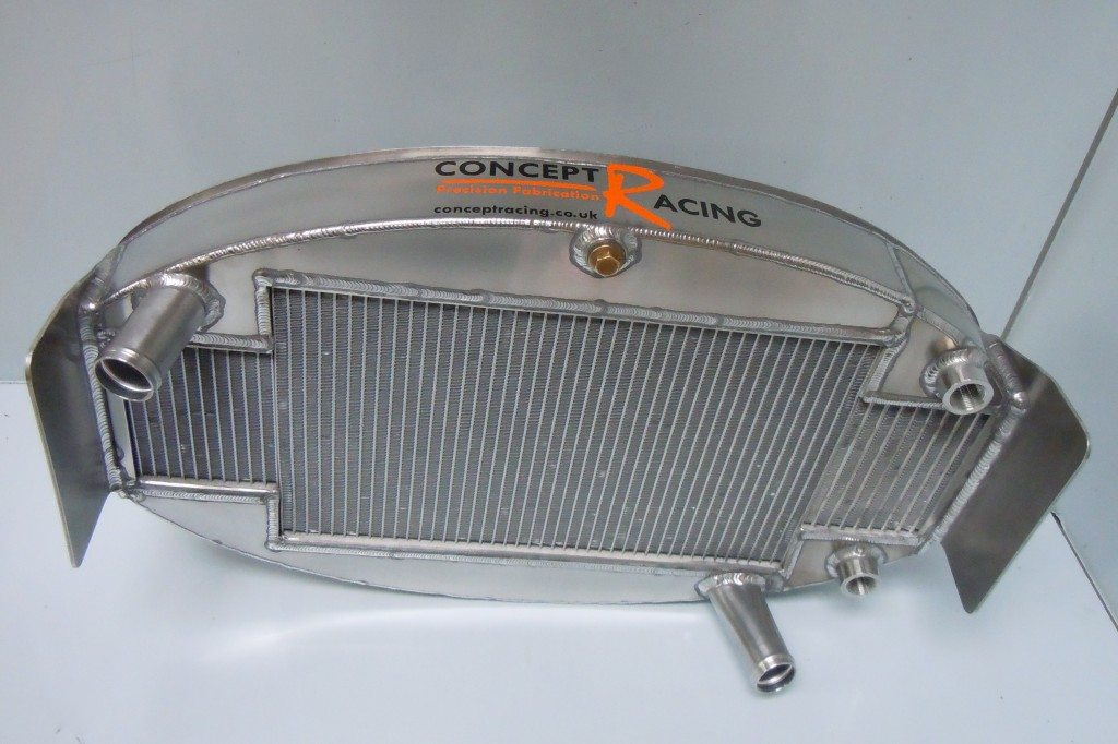 Combined oil cooler and water radiator